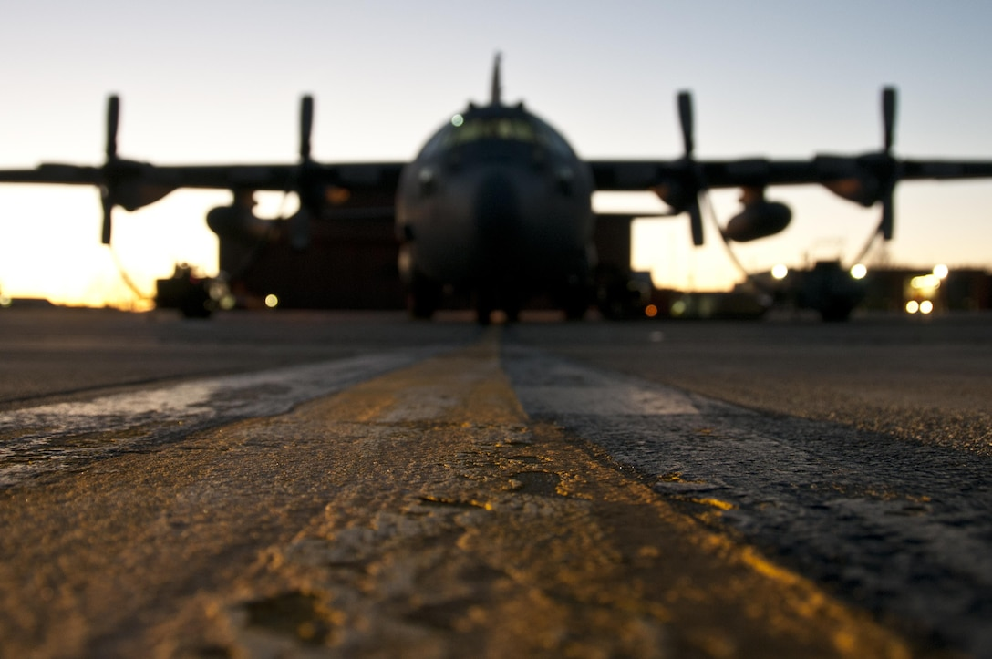 C-130H Hercules sit on a cold flightline as heaters prepare the turbo prop engines for the day at the 179th Airlift Wing, Mansfield, Ohio, Jan. 6, 2015. The Ohio Air National Guard unit is always on mission to respond with highly qualified citizen-airmen to execute Federal, State and community missions. (U.S. Air National Guard photo by Tech. Sgt. Joe Harwood\Released)