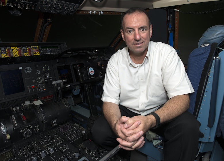 Retired Chief Master Sgt. Bryan Burns, 60th Operations Support Squadron, poses for a photo inside a C-5M Super Galaxy at Travis Air Force Base, Calif., June 6, 2016. Burns flew from McChord Air Force Base, Wash., to Travis AFB on July 9, 1986 in less than two hours to be present for the birth of his son Matthew. Burns served 25 years in the U.S. Air Force and retired in 2007. (U.S. Air Force Photo by Heide Couch/Released)