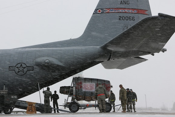 Members of the 179th Airlift Wing Aerial Port Squadron load a prop engine from a C-130H Hercules onto the aircraft for deployment overseas from Mansfield, Ohio, Feb. 25, 2016. The Ohio Air National Guard unit is sending aircrew and operations support as well as maintenance personnel to support their aircraft. The Ohio Air National Guard is always on mission to respond with highly qualified citizen airmen to execute federal, state and community missions. (U.S. Air National Guard photo by Tech. Sgt. Joe Harwood\Released)