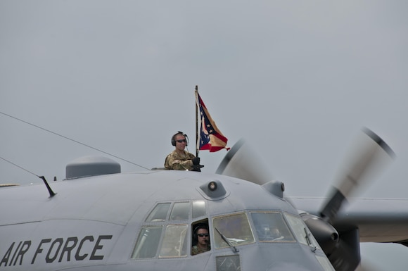 """The Spirit of Lexington"" lands following a tactical arrival over a crowd of Ohio Air National Guard members and their families waiting their return from a deployment with the 179th Airlift Wing, Mansfield, Ohio, July 6, 2016. Over 100 airmen returned from this deployment, ranging from three to six months in support of the C-130H Hercules tactical airlift missions throughout the Middle East. The Ohio Air National Guard unit is always on mission to respond with highly qualified citizen-airmen to execute Federal, State and community missions. (U.S. Air National Guard photo by Tech. Sgt. Joe Harwood\Released)"