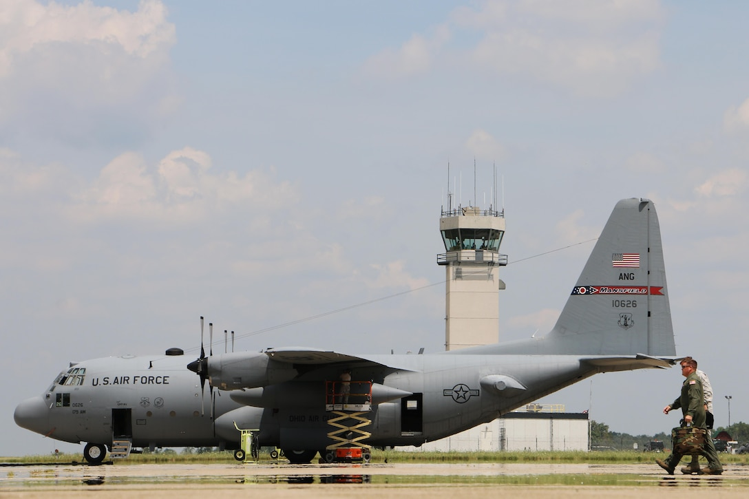 """Brig. Gen. Todd M. Audet, joins 179th Airlift Wing Commander, Col. James R. Camp, during an """"engines running quick crew change"""" on July 21, 2016, in Mansfield, Ohio. The C-130H Hercules crews practice landing and taking back off quickly as well as accelerated loading and off-loading techniques to prepare for such a need in their global missions. The Ohio Air National Guard unit is always on mission to respond with highly qualified citizen-airmen to execute Federal, State and community missions. (U.S. Air National Guard photo by Tech. Sgt. Joe Harwood\Released)"""
