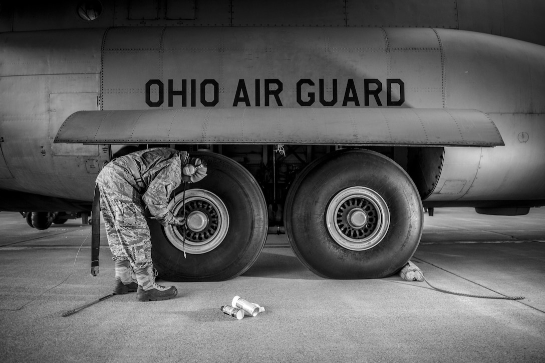 Master Sgt. Michael Meyer checks on the tires of a C-130H Hercules at the 179th Airlift Wing, Mansfield, Ohio, during routine morning maintenance on Dec. 28, 2016. The Ohio Air National Guard unit has a 40 year history of flying airlift missions since it received the first C-130B model in the winter of 1976. (U.S. Air National Guard photo by Tech. Sgt. Joe Harwood\Released)