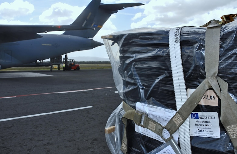 Citizen Airmen of the 315th Airlift Wing delivered over 130,000 pounds of donated humanitarian aid to an outreach organization in Managua, Nicaragua, during a training mission, February 5, 2017.  During the weekend mission, aircrews of two C-17s airlifted over 110,000 pounds of food – enough to provide an estimated 5.4 million meals - as part of the Denton program, which allows for space available on military cargo planes to be used for humanitarian aid. (U.S. Air Force photo by Maj. Wayne Capps)
