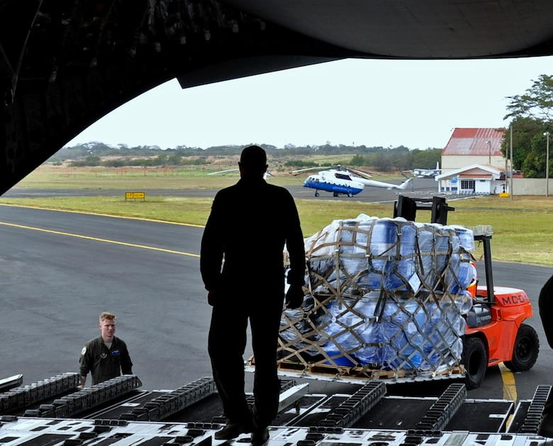 Master Sgt. Drew Cheek, loadmaster with the 300th Airlift Squadron, offloads humanitarian aid cargo from a C-17 aircraft in Managua, Nicaragua, Feb. 5, 2017.  The 315th Airlift Wing delivered the donated cargo to humanitarian organizations, which will provide an estimated 5.4 million meals to children in extreme poverty in Nicaragua and Haiti. (U.S. Air Force photo by 1st Lt. Justin Clark)