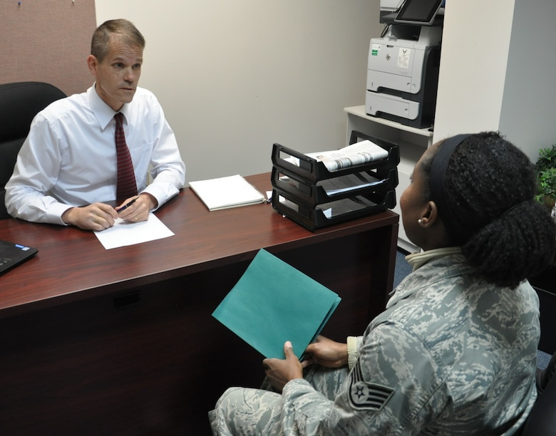 Staff Sgt. Jeria V. Dotson discusses finanancial planning with Micah Neuse, a personal financial counselor at the Airman and Family Readiness Center. (U.S. Air Force photo/W. Eugene Barnett Jr.)