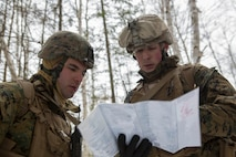 Cpl. Tevfik Ozkaynak (left), a rifleman with Company C, 1st Battalion, 25th Marine Regiment, 4th Marine Division and Sgt. Lee Gugino (right), a squad leader, observe objective points on a map while on a reconnaissance patrol during exercise Riley Xanten II, in Burwash, Ontario, Feb. 3-5, 2017. During the exercise, the Marines joined soldiers from the Canadian Armed Forces to exchange knowledge and increase proficiency in cold weather tactics, survival skills, shelter building, ice fishing, and more. (U.S. Marine Corps photo by Sgt. Sara Graham/released)