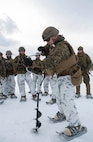 Sgt. Joe Lombardi, squad leader, Company C, 1st Battalion, 25th Marine Regiment, 4th Marine Division, drills a hole into ice to obtain food at exercise Riley Xanten II, in Burwash, Ontario, Feb. 3-5, 2017. During the exercise, the Marines joined soldiers from the Canadian Armed Forces to exchange knowledge and increase proficiency in cold weather tactics, survival skills, shelter building, ice fishing, and more. (U.S. Marine Corps photo by Sgt. Sara Graham/released)