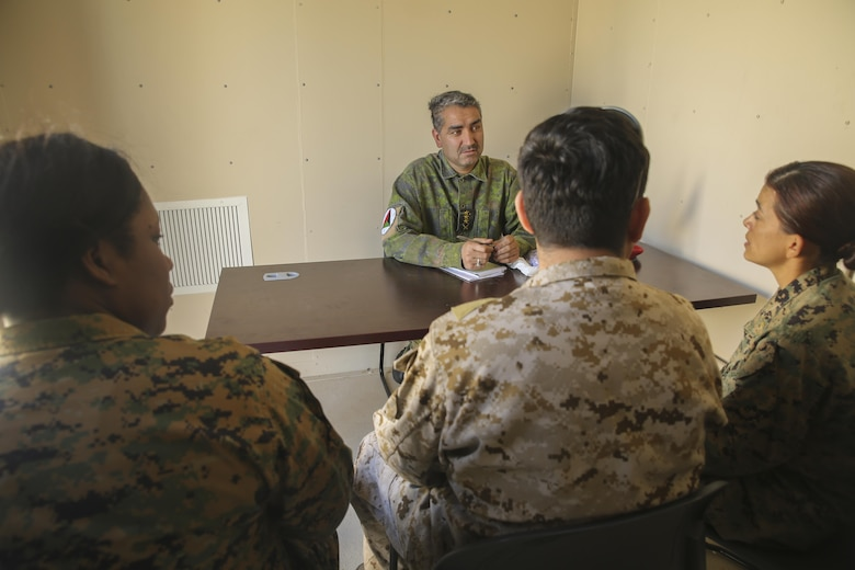 Marines with Task Force Southwest (left, right) speak with an Afghani role player and an interpreter during a rapport-building exercise at Camp Lejeune, N.C., Feb. 2, 2016. Approximately 300 Marines with the unit are preparing for an upcoming deployment to Helmand Province, Afghanistan, where they will train, advise and assist the Afghan National Army 215th Corps and 505th Zone National Police. (U.S. Marine Corps photo by Sgt. Lucas Hopkins)