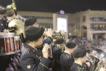 The 1st Infantry Division Band plays to a live crowd during the 2016 Armed Forces Bowl at Amon C. Carter Stadium in Texas Christian University, Fort Worth, Texas, Dec. 23, 2016. The band prefaced this performance with a smaller performance by their brass section at the ticket booth.