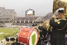 The 1st Infantry Division Band plays service songs during the 2016 Armed Forces Bowl Dec. 23, 2016. The band traveled to Amon C. Carter Stadium at Texas Christian University in Fort Worth, Texas.
