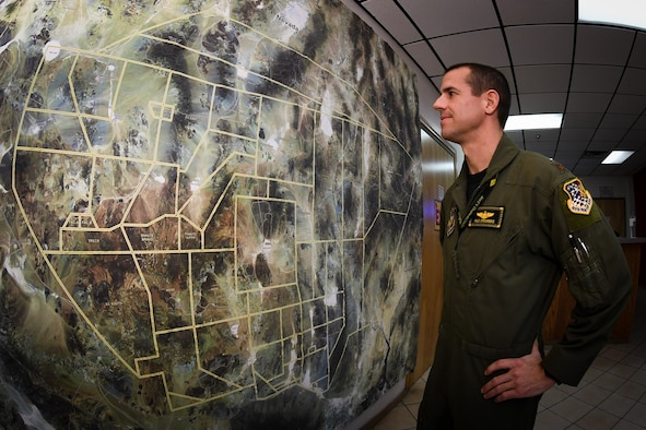 Maj. Shad Stromberg, F-35A pilot in the 419th Fighter Wing, surveys a map of the Nevada Test and Training Range during the Red Flag exercise at Nellis Air Force Base, Nev., Feb. 3. (U.S. Air Force photo/R. Nial Bradshaw)