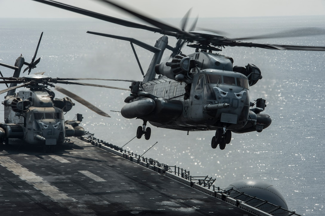 170203-N-LI768-422 GULF OF ADEN (Feb. 3, 2017) A CH-53E Super Stallion helicopter assigned to the Ridge Runners of Marine Medium Tiltrotor Squadron (VMM) 163 takes off from the amphibious assault ship USS Makin Island (LHD 8). The ship is deployed with the Makin Island Amphibious Ready Group to the U.S. 5th Fleet area of operations in support of maritime security operations and theater security cooperation efforts. (U.S. Navy photo by Mass Communication Specialist 3rd Class Devin M. Langer/Released)