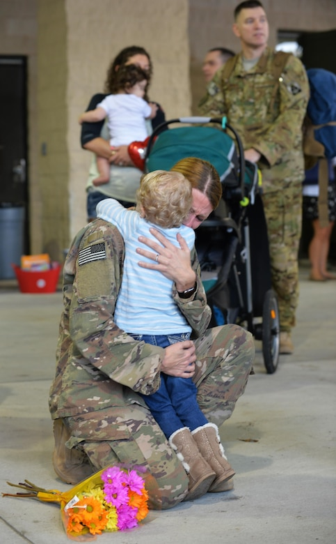 Staff Sgt. Chelsea Neel, a weapons loader team chief with the 801st Aircraft Maintenance Squadron, hugs her daughter during an Operation Homecoming at Hurlburt Field, Fla., Feb. 7, 2017. Neel was one of nearly 190 Air Commandos who were welcomed home by loved ones upon returning from a recent deployment. (U.S. Air Force photo by Senior Airman Andrea Posey)