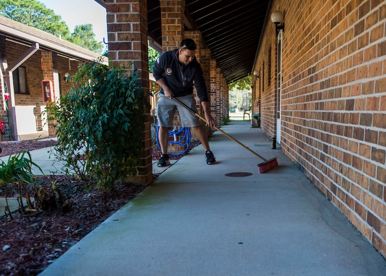Tech. Sgt. Jose Rodriguez, an independent duty medical technician with the 1st Special Operations Support Squadron, sweeps a walk way for a resident at the Bob Hope Village in Shalimar, Fla., Feb. 2, 2017. Airmen from the 4th Special Operations Squadron and the 1st Special Operations Support Squadron spent the morning helping residents with minor tasks around their homes and yards. (U.S. Air Force photo by Senior Airman Krystal M. Garrett)