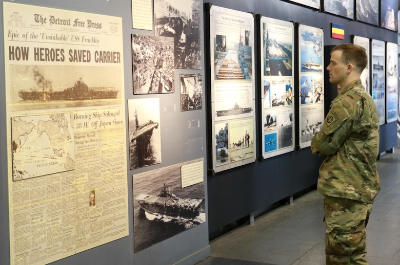 A Paratrooper assigned to 1st Battalion, 505th Parachute Infantry Regiment, 3rd Brigade Combat Team, 82nd Aiborne Division looks at an exhibit aboard the USS Yorktown and Medal of Honor Museum at Charleston, S.C. , Feb. 2, 2017.                The Paratroopers traveled to Charleston to honor and recognize military history and train with U.S. Air Force crewmembers for a training event. (U.S. Army photo by Sgt. Anthony Hewitt)