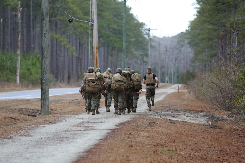 Martial Arts Instructor course students conduct a hike during the course's culminating event aboard Marine Corps Air Station Cherry Point, N.C., Feb. 3, 2017.The Marines endured three weeks of intense training, including: public speaking, written examinations, practical application of techniques, and how to be a proficient Marine Corps Martial Arts Program Instructor. More than 20 Marines graduated the course. (U.S. Marine Corps photo by Lance Cpl. Cody Lemons/Released)