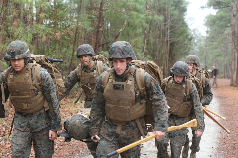 Marines in the Martial Arts Instructor course conduct a notional casualty extract during the course's culminating event aboard Marine Corps Air Station Cherry Point, N.C., Feb. 3, 2017. The course instills the skills necessary to proficiently instruct the disciplines of the Marine Corps Martial Arts Program to fellow Marines. The Marines endured physically and mentally demanding tasks on their way to graduating and becoming MCMAP instructors. (U.S. Marine Corps photo by Lance Cpl. Cody Lemons/Released)