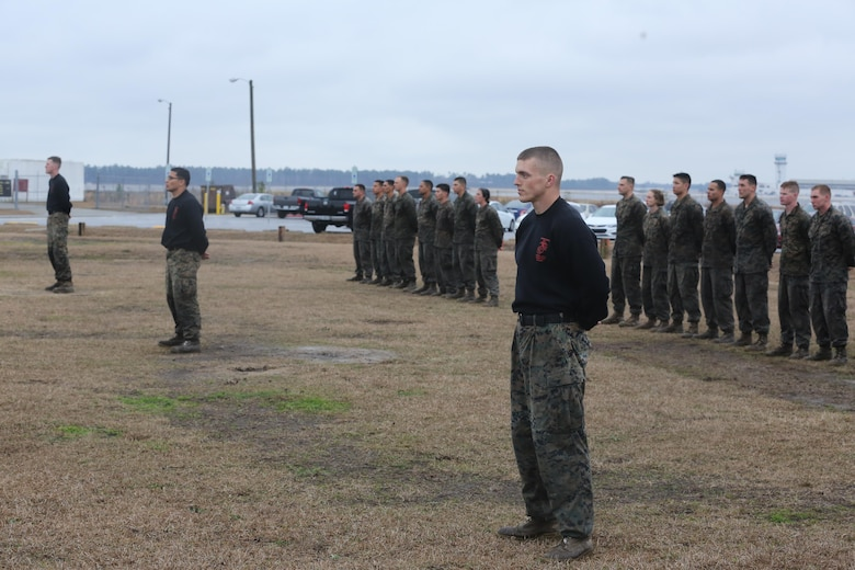 Marines enrolled in the Martial Arts Instructor course stand in formation while they wait to graduate aboard Marine Corps Air Station Cherry Point, N.C., Feb. 3, 2017. More than 20 Marines graduated the strenuous course and were declared Marine Corps Martial Art Program instructors. The course taught the Marines the necessary skills to properly and proficiently instruct MCMAP to fellow Marines. (U.S. Marine Corps photo by Lance Cpl. Cody Lemons/Released)
