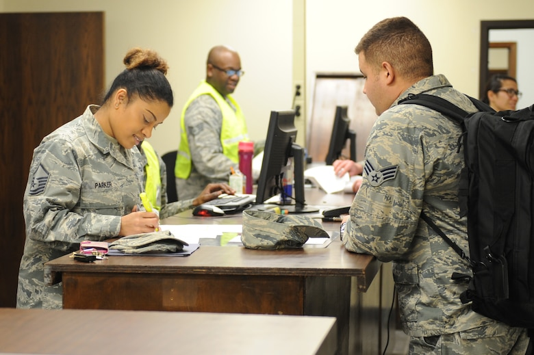 U.S. Air Force Master Sgt. Shobha Parker, 7th Logistics Readiness Squadron traffic management section chief, (left) processes Senior Airman Jose Martinez, 7th Logistics Readiness Squadron, for deployment at Dyess Air Force Base, Texas, Jan. 31, 2017. Dyess Airmen deployed to Andersen Air Force Base, Guam, to relieve the 34th Expeditionary Bomb Squadron from Ellsworth Air Force Base, S.D. (U.S. Air Force photo by Airman 1st Class Emily Copeland)