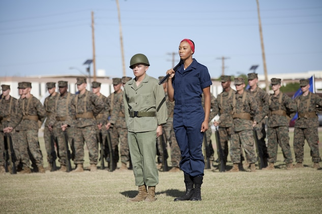 U.S. Marines with Headquarters and Headquarters Squadron participate in a historical uniform pageant at Marine Corps Air Station Yuma, Ariz., Nov. 10, 2016.  The ceremony celebrates the 241st birthday of the Marine Corps, and serves to honor Marines of the past, present and future while signifying the passing of traditions from one generation to the next. (U.S. Marine Corps photo by Lance Cpl. Joel Soriano/Released)
