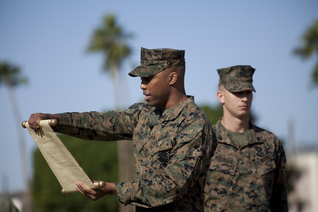 U.S. Marine Corps Lt. Daryl Scales, the Headquarters and Headquarters Squadron adjutant, reads the 13th Commandant's birthday message as part of the annual cake cutting ceremony at Marine Corps Air Station Yuma, Ariz., Nov. 10, 2016. The ceremony celebrates the 241st birthday of the Marine Corps, and serves to honor Marines of the past, present and future while signifying the passing of traditions from one generation to the next. (U.S. Marine Corps photo by Lance Cpl. Joel Soriano/Released)