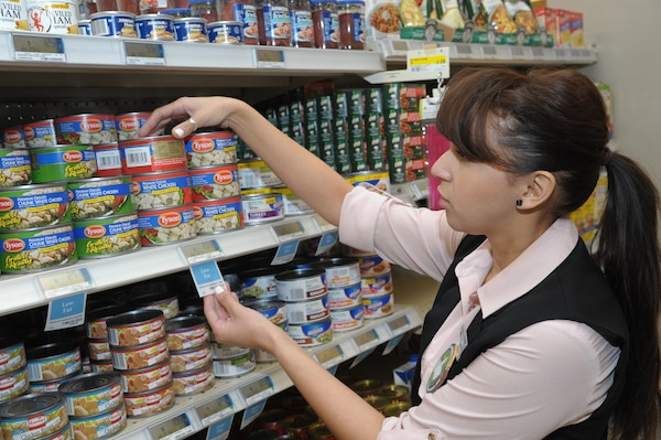 Claudia Smith, commissary manager, reads the guide label on can goods, during the Go for Green program at Joint Base San Antonio-Randolph. Feb. 2, 2017.  Go for Green is a nutritional recognition labeling system providing a quick assessment of the nutritional value of menu offerings and food products.