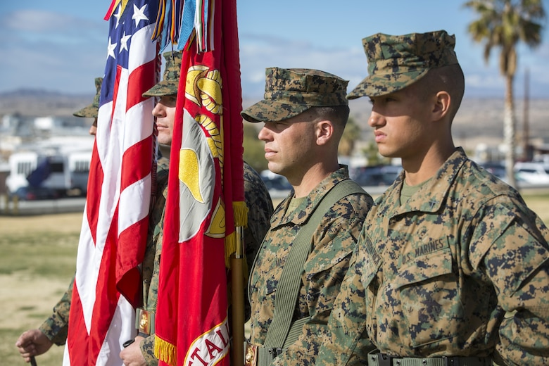The color guard for 2nd Battalion, 7th Marine Regiment, carries the colors during a relief and appointment ceremony at Lance Cpl. Torrey L. Gray Field, Feb. 3, 2017. During the ceremony, Sgt. Maj. Gabriel E. Macias relinquished his post as battalion sergeant major to Sgt. Maj. Jared A. Hoversten. (U.S. Marine Corps photo by Cpl. Levi Schultz)