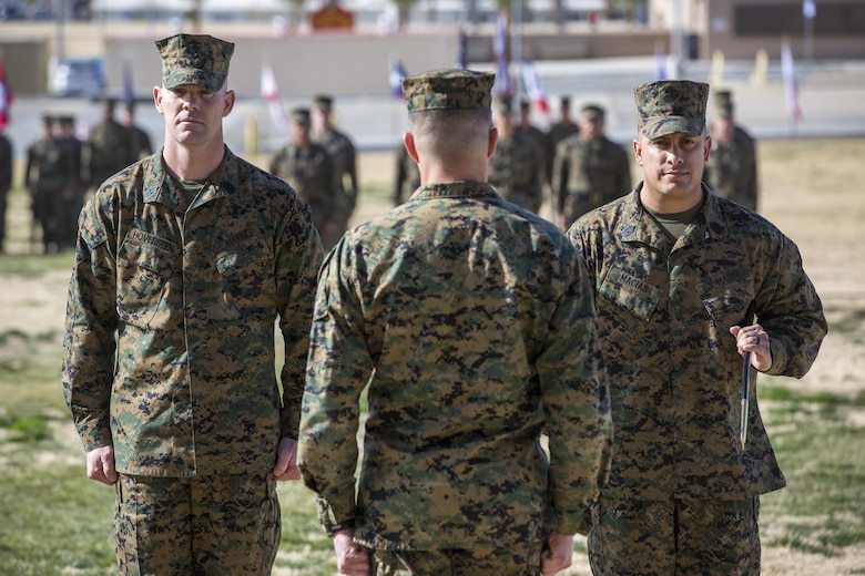 Sgt. Maj. Jared A. Hoversten, left, and Sgt. Maj. Gabriel E. Macias perform the traditional passing of the noncommissioned officer sword during a relief and appointment ceremony at Lance Cpl. Torrey L. Gray Field, Feb. 3, 2017. During the ceremony, Macias relinquished his post as battalion sergeant major for 2nd Battalion, 7th Marine Regiment, to Hoversten. (U.S. Marine Corps photo by Cpl. Levi Schultz)