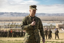 Lt. Col. John Kenney, commanding officer, 2nd Battalion, 7th Marine Regiment, speaks during a relief and appointment ceremony at Lance Cpl. Torrey L. Gray Field, Feb. 3, 2017. During the ceremony, Sgt. Maj. Gabriel E. Macias relinquished his post as battalion sergeant major to Sgt. Maj. Jared A. Hoversten. (U.S. Marine Corps photo by Cpl. Levi Schultz)