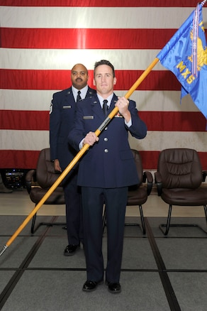 170205-Z-FN720-020 -- Capt. Anthony Peplinski holds the guidon during an assumption of command ceremony for the 127th Maintenance Squadron at Selfridge Air National Guard Base, Mich., on February 5, 2017. Capt. Peplinski replaces Col. David Spehar, who now serves as the 127th Maintenance Group Commander. The 127th MXS and MXG maintain the A-10 Thunderbolt II aircraft at Selfridge. (U.S. Air National Guard photo by SrA Ryan Zeski)