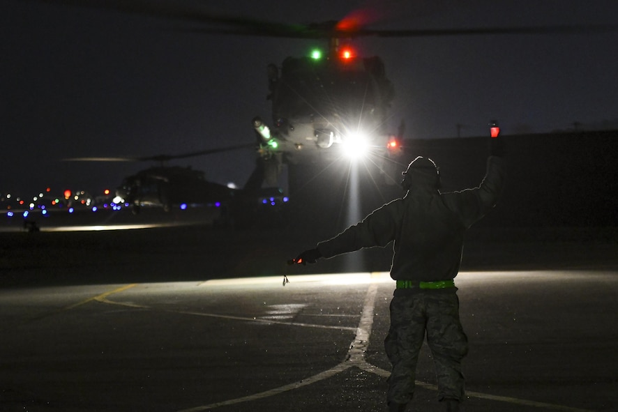An Airman assigned to the 718th Aircraft Maintenance Squadron from Kadena Air Base, Japan, marshals an HH-60 Pave Hawk taking off for a combat search and rescue training mission at Osan Air Base, Republic of Korea, Feb. 2, 2017. The mission was part of Exercise Pacific Thunder, which is a Pacific Air Forces-wide exercise that provides rescue teams with a realistic scenario to practice CSAR missions in mountainous Korean terrain. (U.S. Air Force photo by Staff Sgt. Vic tor J. Caputo)