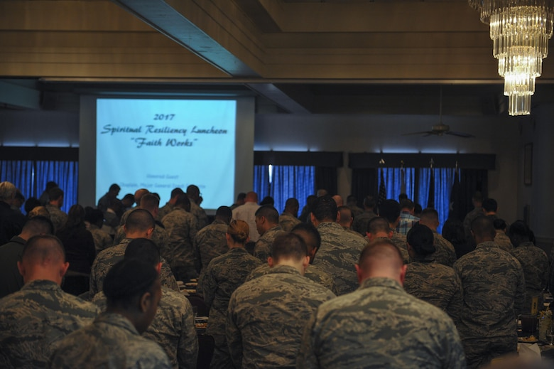 U.S. Air Force members and civilian attendees bow their heads to pray during a spiritual resiliency luncheon at Kunsan Air Base, Republic of Korea, Feb. 7, 2017. In 1953, members of the Senate and House prayer groups established, with President Eisenhower, the first presidential prayer breakfast. Kunsan continued the tradition and invited Maj. Gen. Dondi E. Costin, chief of chaplains, Headquarters U. S. Air Force, the Pentagon, Washington, D.C., to speak about spiritual resilience. (U.S. Air Force photo by Senior Airman Colville McFee/Released)