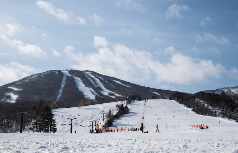 Skiers prepare to ride a lift at a ski resort in Hachimantai, Japan, Jan. 29, 2017. Misawa Air Base's chaplain corps provided an opportunity for Airmen to exercise their resiliency tools during a ski trip. (U.S. Air Force photo by Airman 1st Class Sadie Colbert)
