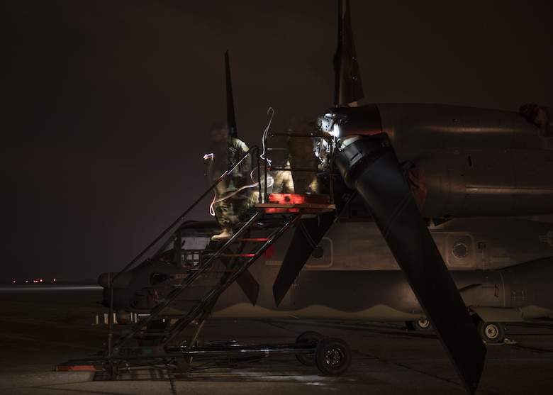 Crew chiefs assigned to the 352d Special Operations Maintenance Squadron repair a CV-22 Osprey after dark Jan. 31, 2017, on Zadar Air Base, Croatia. Maintenance, communication and auxiliary personnel deployed alongside aircrews in support of training objectives at Croatia's Multi-national Aviation Training Complex. (U.S. Air Force photo/1st Lt. Chris Sullivan)