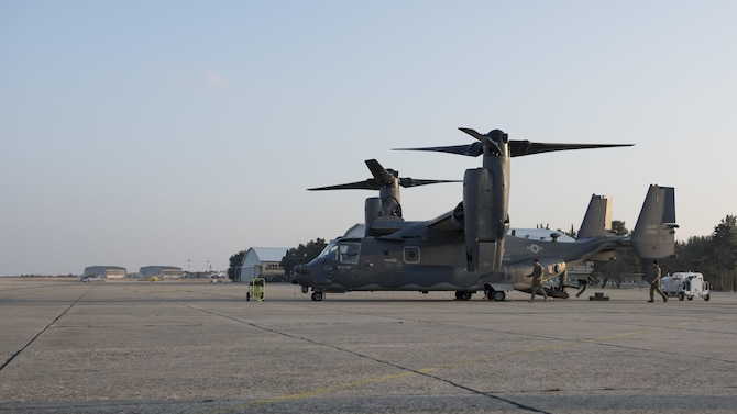 U.S. special-mission aviators assigned to the 7th Special Operations Squadron approach a CV-22 Osprey to perform pre-flight checks Jan. 30, 2017, on Zadar Air Base, Croatia. More than 50 Airmen from the 352d Special Operations Wing deployed to the site to support and conduct mission-essential proficiency training at Croatia's Multi-national Aviation Training Center. (U.S. Air Force photo/1st Lt. Chris Sullivan)