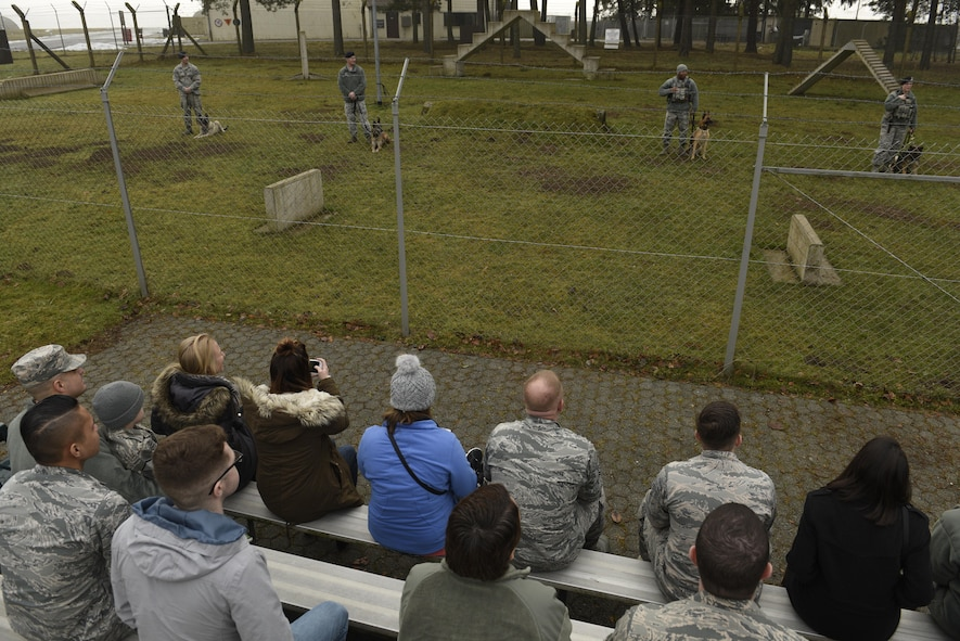 Annual award nominees watch a demonstration by the 52nd Security Forces Squadron military working dogs on Spangdahlem Air Base, Germany, Feb. 2, 2017. The nominees were given a base tour which included the fire department, MWD and explosive ordnance disposal. (U.S. Air Force photo by Staff Sgt. Jonathan Snyder)