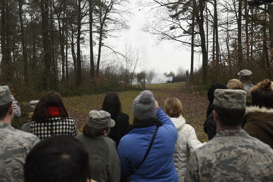 Annual award nominees watch a controlled detonation by Airmen of the 52nd Civil Engineer Squadron explosive ordnance disposal on Spangdahlem Air Base, Germany, Feb. 2, 2017. The nominees were given a base tour which included the fire department, military working dogs and EOD. (U.S. Air Force photo by Staff Sgt. Jonathan Snyder)