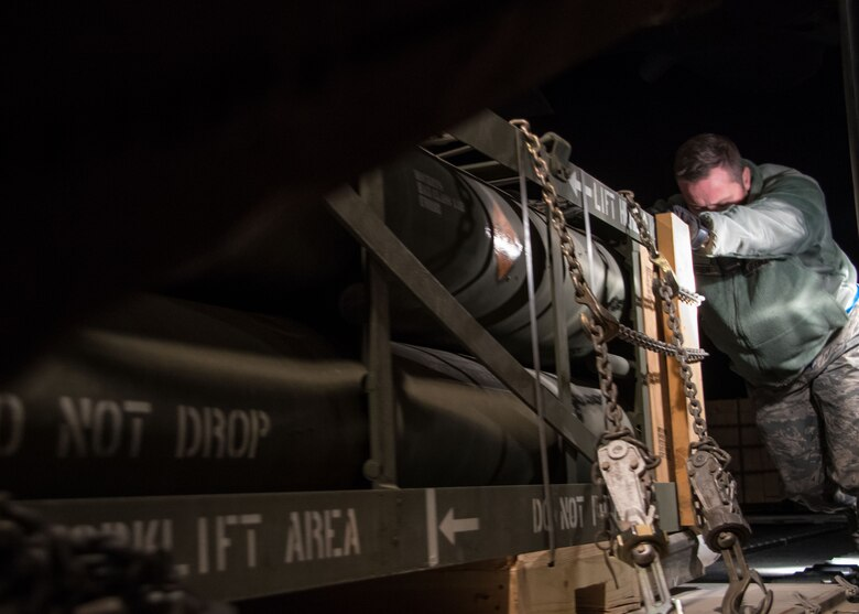 A 386th Expeditionary Logistics Readiness Squadron aerial porter pushes a pallet of rockets into the cargo area of a C-130H Hercules at an undisclosed location in Southwest Asia, Feb. 3, 2017. The aerial porters work with loadmasters to ensure the weight of the cargo is properly distributed to not affect the aircraft's flight. (U.S. Air Force photo/Senior Airman Andrew Park)