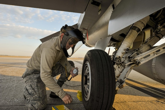 U.S. Air Force Airmen First Class Shawna Bucher, F-16 crew chief assigned to the 180th Fighter Wing, Ohio Air National Guard, ensures proper air pressure in the tires on an F-16 Fighting Falcon during a training exercise at MacDill Air Force Base in Tampa, Florida on Feb. 2, 2017. The 180th brought their F-16s and approximately 150 maintainers, pilots, and operations specialists to MacDill AFB for a two week training exercise which included basic fighter maneuvers against F-18 Hornets from the Canadian 425th Tactical Fighter Squadron, sharpening the combat capabilities of the OANG Airmen. (Air National Guard photo by Tech. Sgt. Nic Kuetemeyer)