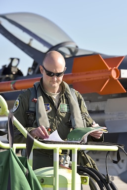 U.S. Air Force Capt. Seth Murray, a pilot assigned to the 180th Fighter Wing, Ohio Air National Guard, reviews critical information and maintenance notes about the F-16 Fighting Falcon during a training exercise at MacDill Air Force Base in Tampa, Florida on Feb. 2, 2017. The 180th brought F-16s and more than 150 maintainers, pilots, and operations support personnel to MacDill AFB for a two-week training exercise which included basic fighter maneuvers against F-18 Hornets from the Canadian 425th Tactical Fighter Squadron, sharpening the combat capabilities of 180FW Airmen. (U.S. Air National Guard photo by Tech. Sgt. Nic Kuetemeyer)