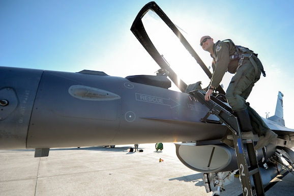 "U.S. Air Force Capt. Seth Murray, F-16 pilot assigned to the 180th Fighter Wing, Ohio Air National Guard, climbs in to the cockpit of an F-16 Fighting Falcon, ready to join in the ""fight"" during a training exercise at MacDill Air Force Base in Tampa, Florida on Feb. 2, 2017. The 180th brought their F-16s and approximately 150 maintainers, pilots, and operations specialists to MacDill AFB for a two week training exercise which included basic fighter maneuvers against F-18 Hornets from the Canadian 425th Tactical Fighter Squadron, sharpening the combat capabilities of the OANG Airmen. (Air National Guard photo by Tech. Sgt. Nic Kuetemeyer)"
