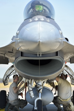 F-16 crew chiefs assigned to the 180th Fighter Wing, Ohio Air National Guard, inspect the hydraulic landing gear systems of an F-16 Fighting Falcon, inches away from the howling engine intake, just after the jet landed during a training exercise at MacDill Air Force Base in Tampa, Florida on Feb. 2, 2017. The 180th brought their F-16s and approximately 150 maintainers, pilots, and operations specialists to MacDill AFB for a two week training exercise which included basic fighter maneuvers against F-18 Hornets from the Canadian 425th Tactical Fighter Squadron, sharpening the combat capabilities of the OANG Airmen. (Air National Guard photo by Tech. Sgt. Nic Kuetemeyer)