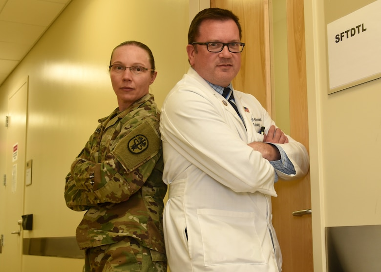 U.S. Army Maj. Lynn Wagner, Armed Forces Medical Examiner System Division of Forensic Toxicology Special Forensic Toxicology Drug Testing Facility chief, and Dr. Jeffrey Walterscheid, AFMES Division of Forensic Toxicology chief toxicologist, pose for a photo Jan. 30, 2017, at AFMES on Dover Air Force Base, Delaware. Wagner and Walterscheid want to let service members know they are watching and making sure they do not get away with doing synthetic cannabinoids. (U.S. Air Force photo by Senior Airman Ashlin Federick)