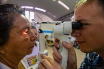 PUERTO BARRIOS, Guatemala (Feb. 4, 2017) -- Hospital Corpsman 3rd Class Brandon Morrison, a native of Tacoma, Wash., assigned to Naval Branch Health Clinic Belle Chasse, La., performs an eye exam on a host nation patient at the Continuing Promise 2017 (CP-17) medical site in Puerto Barrios, Guatemala. CP-17 is a U.S. Southern Command-sponsored and U.S. Naval Forces Southern Command/U.S. 4th Fleet-conducted deployment to conduct civil-military operations including humanitarian assistance, training engagements, and medical, dental, and veterinary support in an effort to show U.S. support and commitment to Central and South America. (U.S. Navy Combat Camera photo by Petty Officer 2nd Class Brittney Cannady)