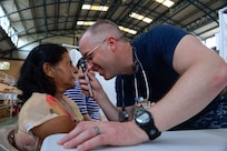 PUERTO BARRIOS, Guatemala (Feb. 4, 2017) -- Cmdr. Michael Arnold, a native of Chelmsford, Mass., and family medicine doctor assigned to Naval Hospital Jacksonville, Fla., examines a host nation patient at the Continuing Promise 2017 (CP-17) medical site in Puerto Barrios, Guatemala. CP-17 is a U.S. Southern Command-sponsored and U.S. Naval Forces Southern Command/U.S. 4th Fleet-conducted deployment to conduct civil-military operations including humanitarian assistance, training engagements, and medical, dental, and veterinary support in an effort to show U.S. support and commitment to Central and South America. (U.S. Navy Combat Camera photo by Petty Officer 2nd Class Brittney Cannady)