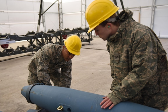 U.S. Air Force Airman 1st Class Jeremiah L. Buckmaster and Airman 1st Class Joshua E. Holland, munitions systems specialists assigned to the 180th Fighter Wing, Ohio Air National Guard, inspect inert Mark 82 bomb bodies Feb. 5, 2017, at the Toledo Express Airport in Swanton, Ohio. Munitions systems specialists procure, inspect, store, recondition, issue, transport, maintain, test and assemble GPS/laser guided and unguided munitions for 180FW F-16 Fighting Falcons.