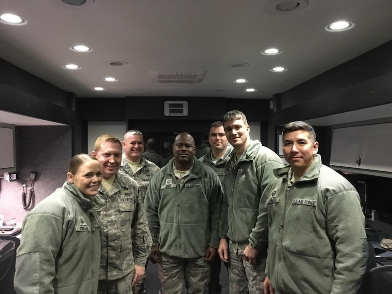 The North Carolina Air National Guard Mobile Emergency Operations Center (MEOC) team poses for a group photo to commemorate their experience supporting the 58th United States Presidential inauguration. From Left to Right, Master Sg.t Rebecca Tongen, Staff Sgt. Mark Fow, Senior Master Sgt. James Cutshaw, Master Sgt. Timothy Jones, Staff Sergeant Benjamin Elliot, Brigadier Gen. Staudenraus, and Master Sgt. Erik Kennedy. The team's mission is to provide backup communications to three tactical operations centers Task Force Security, Task Force Crowd, and Task Force Access, in Washington D.C. About 8000 soldiers and airmen are tasked to support the ceremony on Jan. 20, 2017. (U.S. Air National Guard photo credited to Master Sgt. Rebecca S. Tongen)