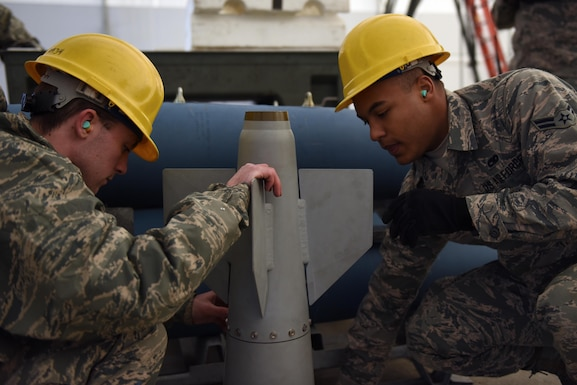 U.S. Air Force Airman 1st Class Joshua E. Holland and Airman 1st Class Jeremiah L. Buckmaster, munitions systems specialists assigned to the 180th Fighter Wing, Ohio Air National Guard, inspect a GPS guided airfoil group Feb. 5, 2017 at the Toledo Express Airport in Swanton, Ohio. Munitions systems specialists procure, inspect, store, recondition, issue, transport, maintain, test and assemble GPS/laser guided and unguided munitions for 180FW F-16 Fighting Falcons. (U.S. Air National Guard photo by Staff Sgt. John Wilkes)