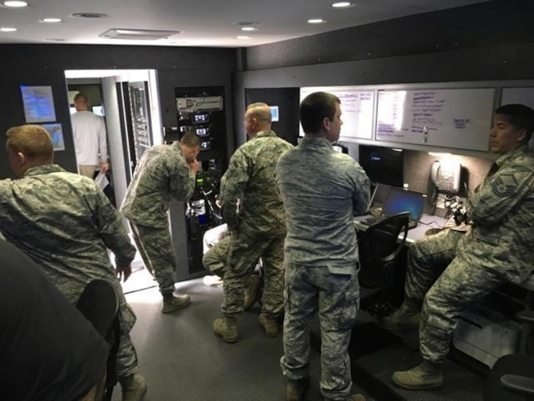 The North Carolina Air National Guard Mobile Emergency Operations Center (MEOC) team works diligently to provide backup communications to three tactical operations centers Task Force Security, Task Force Crowd, and Task Force Access, in Washington D.C., Jan. 19, 2017. The team consists of National Guard Airmen Master Sg.t Rebecca Tongen, Staff Sgt. Mark Fow, Senior Master Sgt. James Cutshaw, Master Sgt. Timothy Jones, Staff Sergeant Benjamin Elliot, Brigadier Gen. Staudenraus, and Master Sgt. Erik Kennedy. About 8000 soldiers and airmen are tasked to support the 58th United States presidential inauguration on Jan. 20, 2017. (U.S. Air National Guard photo credited to Master Sgt. Rebecca S. Tongen)