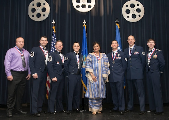"The 2016 436th Airlift Wing Annual Award winners pose for a group photo following the 2016 Annual Awards Ceremony Feb. 3, 2017, at the Rollins Center inside of Dover Downs, Dover, Del. This year's ceremony theme was ""A night with the Stars.""(U.S. Air Force photo by Staff Sgt. Jared Duhon)"